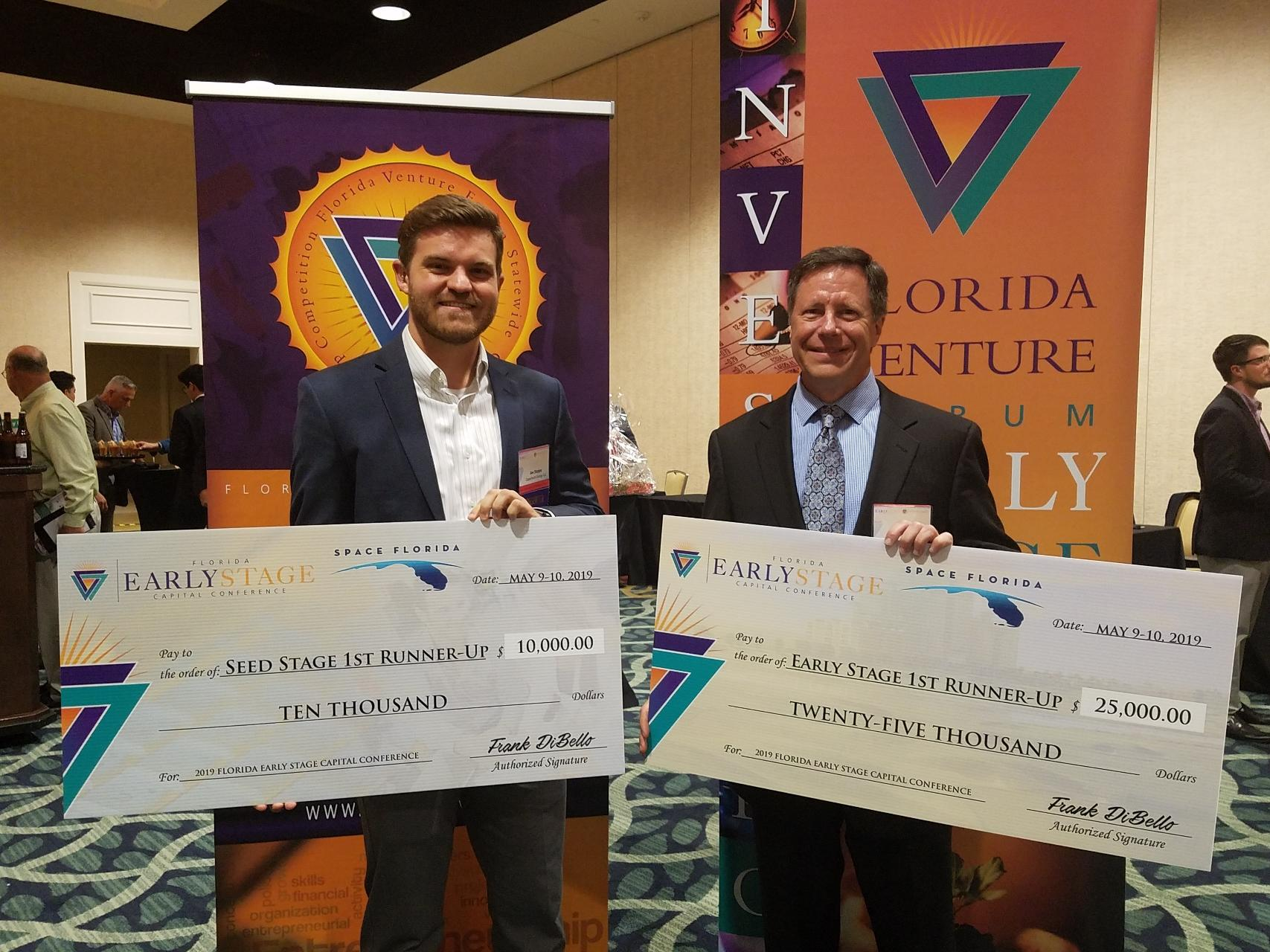 Joe Sleppy (left) of Capacitech Energy and Rodney Bosley (right) of SegAna at the Florida Venture Forum award ceremony in the Omni Resort in Orlando, Florida.