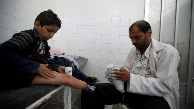 Yassir Abdulrahman, 10, who lost his leg in a Saudi-led air strike that hit near his family's home, has a checkup in Sanaa, Yemen [Khaled Abdullah/Reuters]