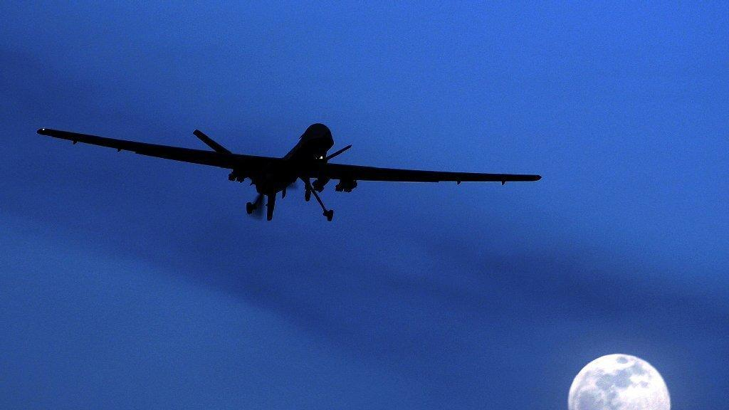 An unmanned U.S. drone, seen here in 2010, flies over Kandahar, Afghanistan. (Kirsty Wigglesworth / Associated Press)