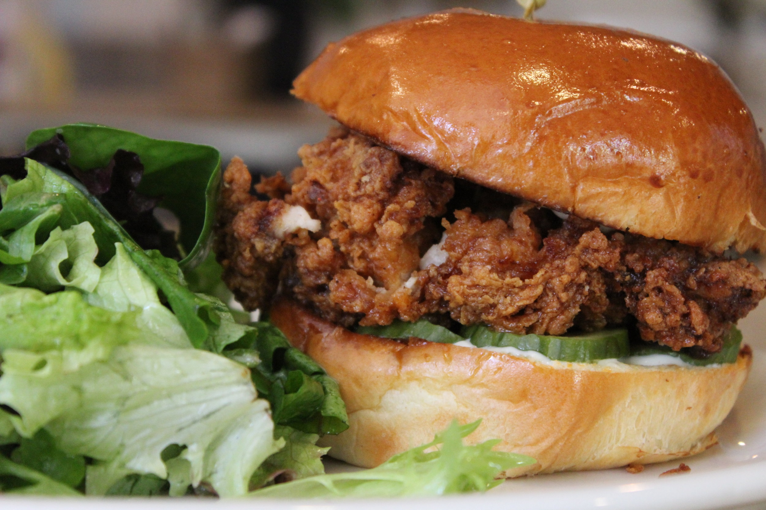 Fried Chicken Sandwich with side of mixed greens salad