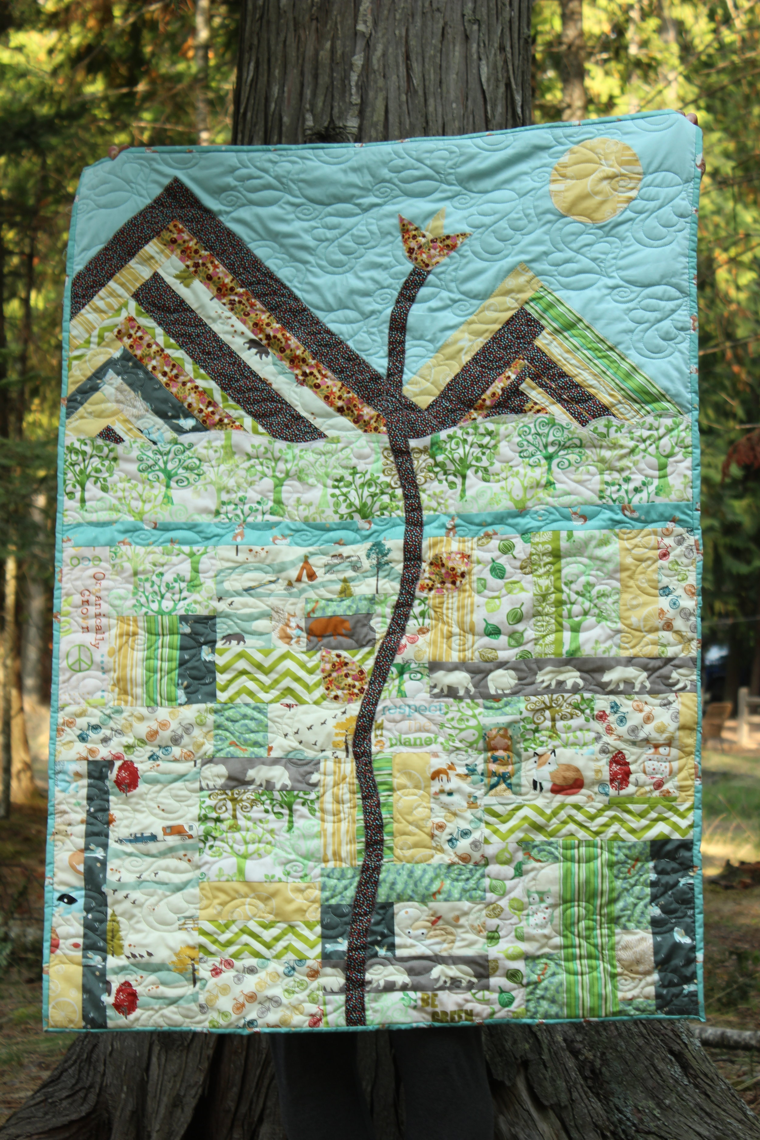 """I called the Quilt """"Little Bud"""". The quilt is 100% organic including the batting (but excluding the thread). I was able to find some organic at my local stores My Sewing Room and Along Came Quilting and ordered the rest from fabricworm in California."""