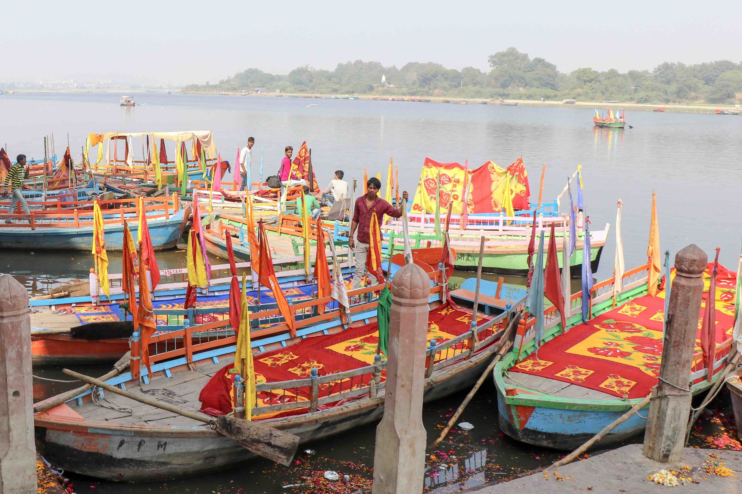Colourful boats on holy river Yamuna in Mathura, India.