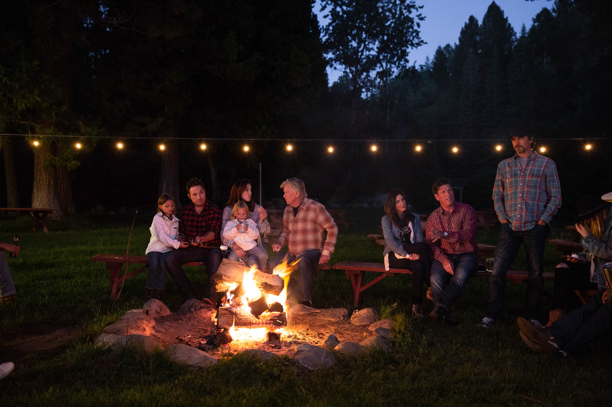 Family bonding vacation around the campfire