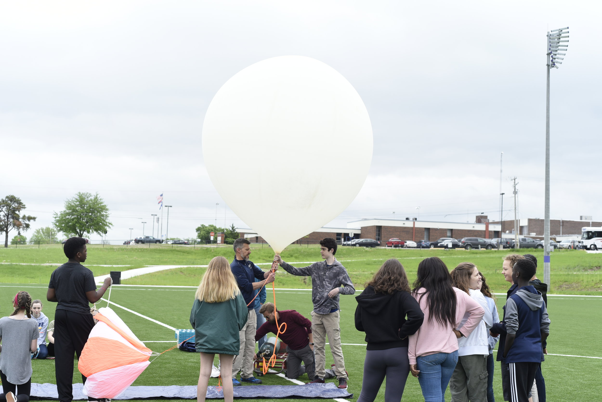 The weather balloon filling up with helium, getting ready for takeoff.