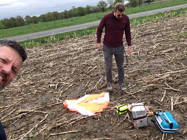 Mr. Luther and Mr. Vasquez retrieving the popped weather balloon near Bowling Green, MO.