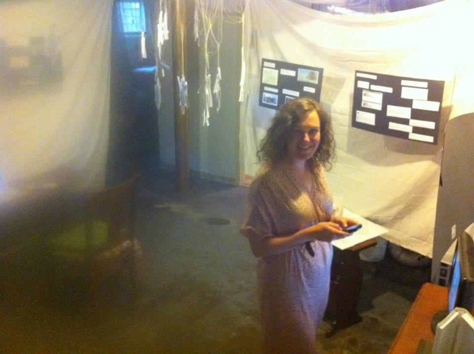 Here's a pic I snapped while proposing to Meagen. I made her basement into an art gallery. June 2012.