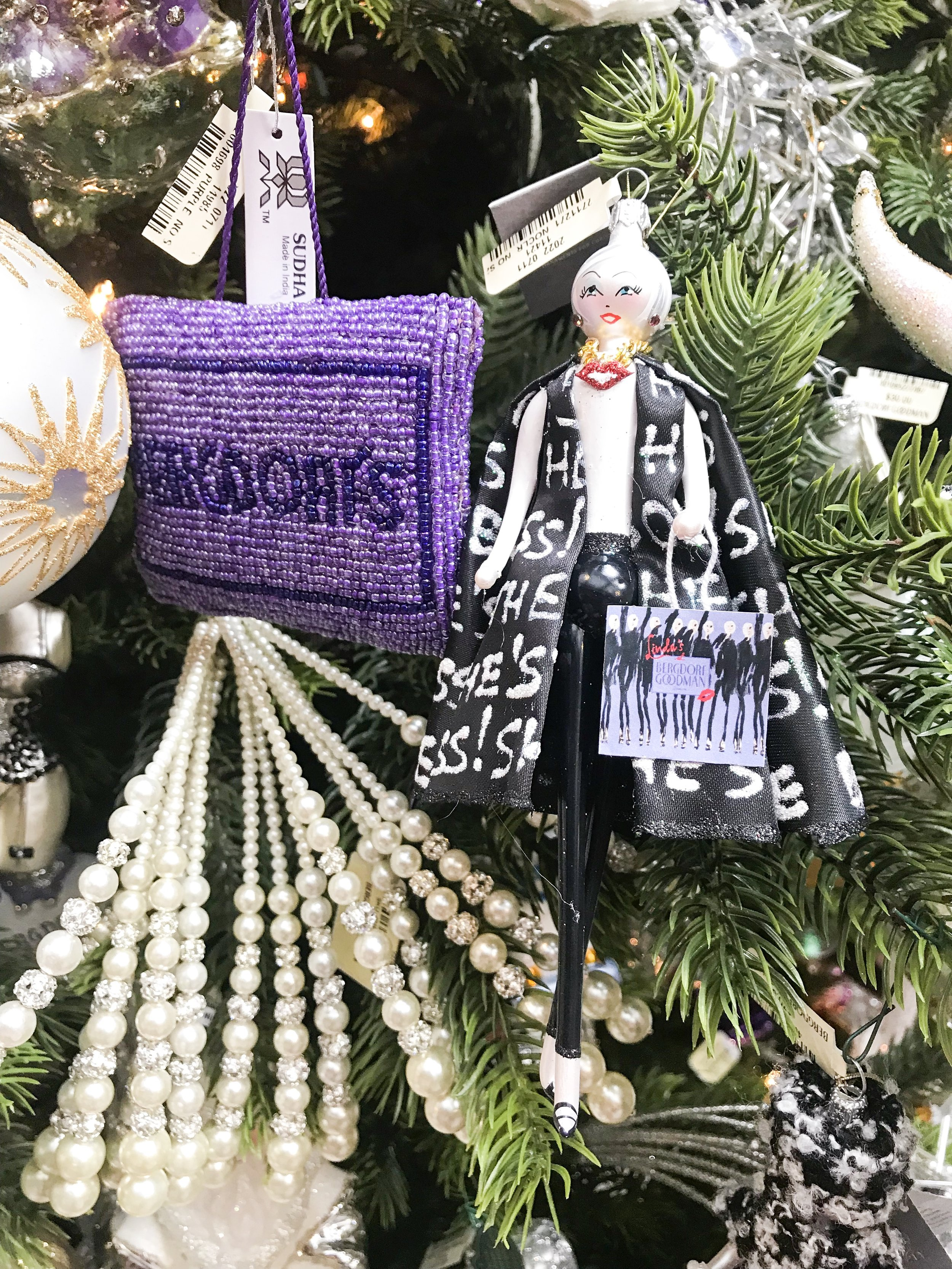 "linda fargo, senior Vice President of bergdorf goodman, holding a bag to her signature shop ""linda's at bg"" located inside bergdorf goodman."