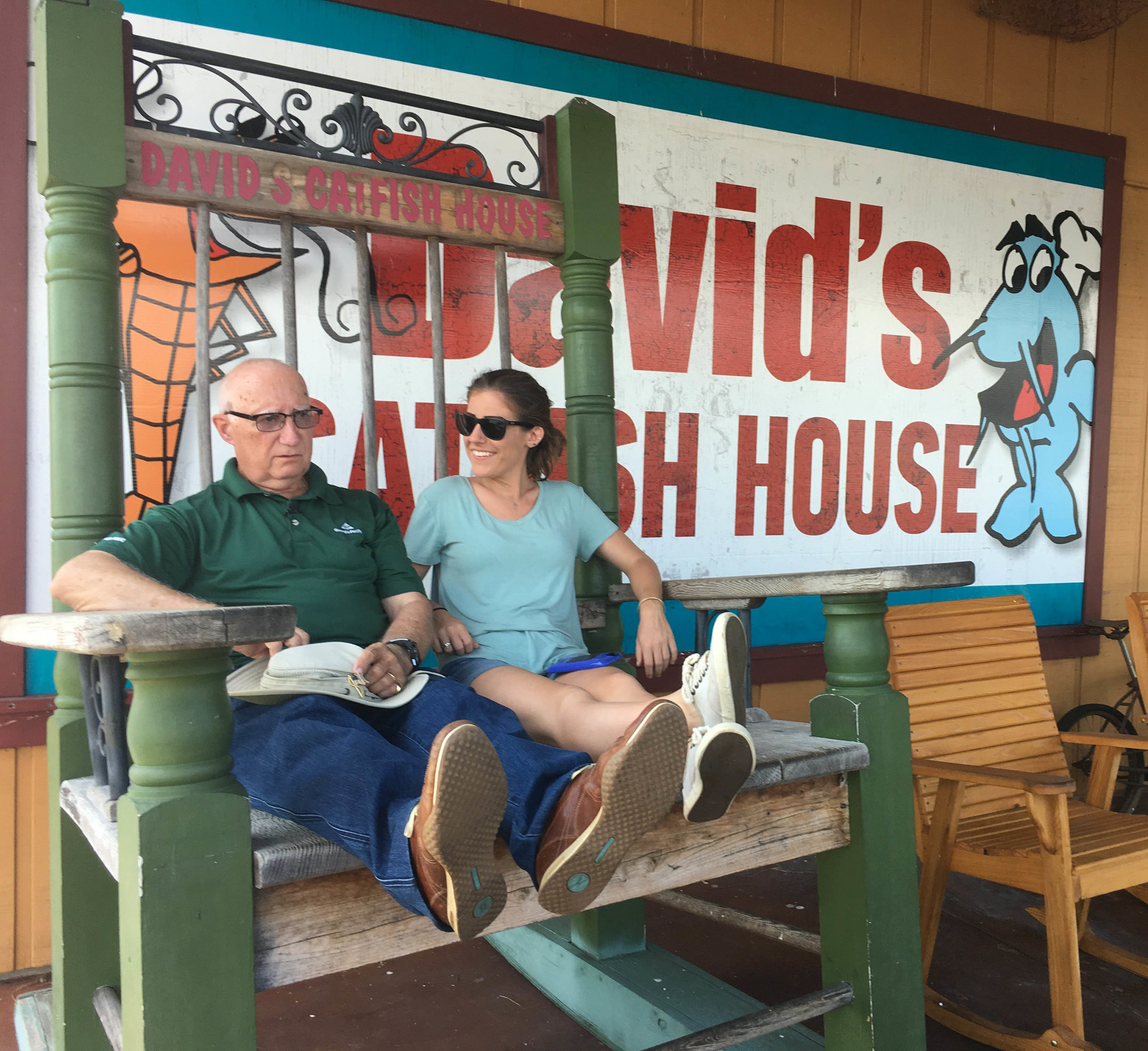 Glen with DP Emily Breault hanging on a rocking chair outside David's Catfish House. Might be the only time he wasn't smiling on the entire shoot.