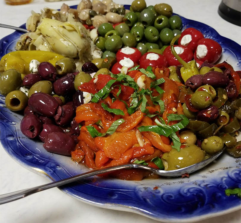 Lovely antipasto platter for the table sitting on of my grandmother's serving dishes.