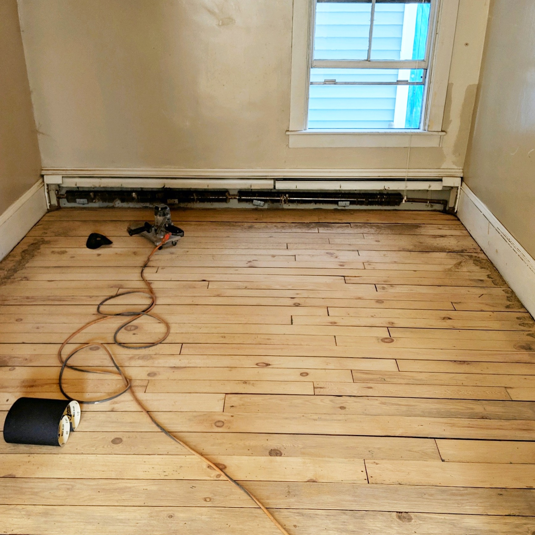 After the room was cleared and the floors sanded…what a difference already!