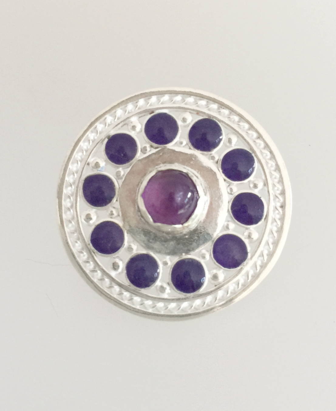 Round with Cabochon Enamel and Central Amethyst