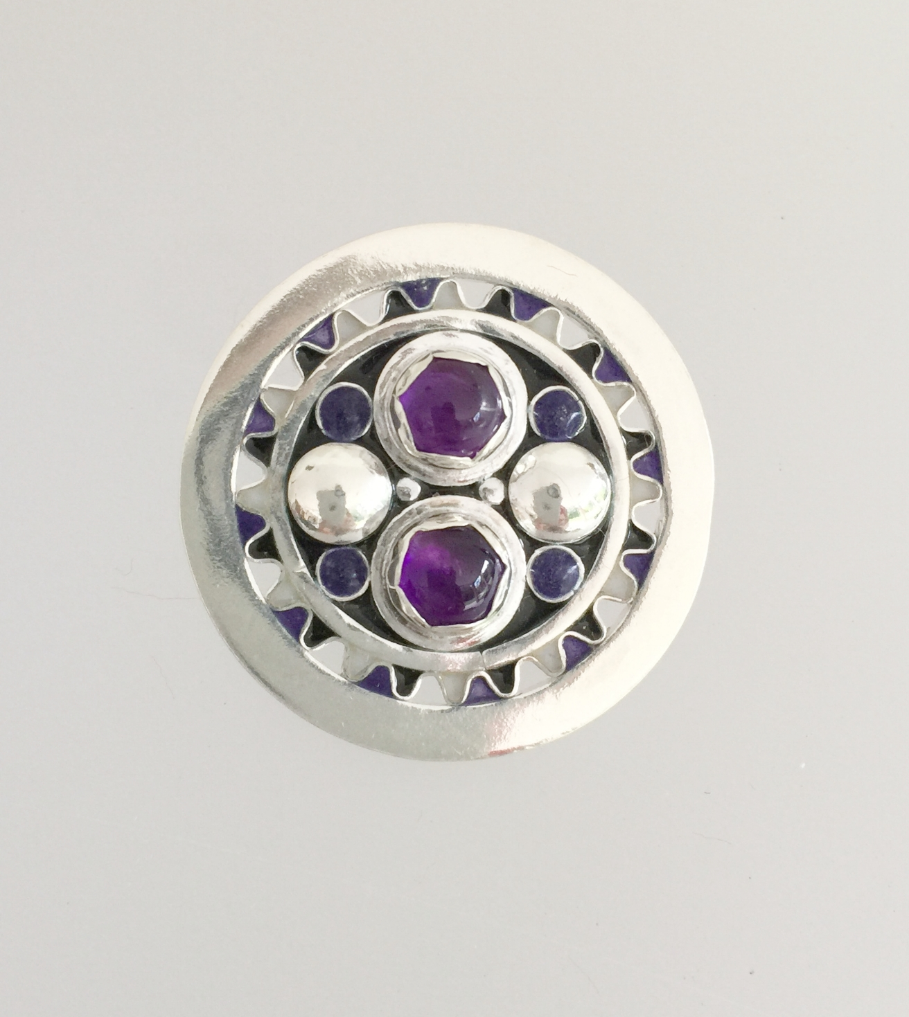 Round with Cabochon Enamel and Two Amethyst Cabochons