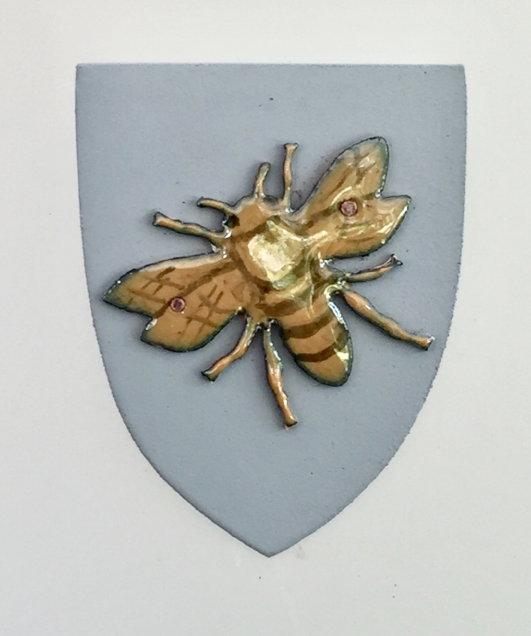 Golden Bee on Grey Shield