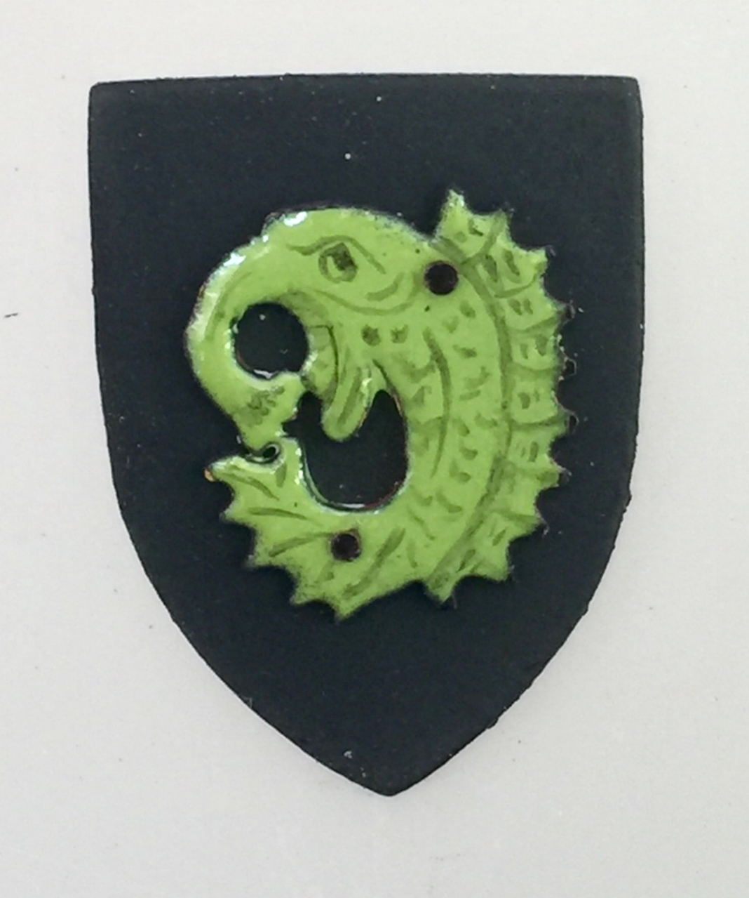 Green Fantastical Sea-Creature on Black Shield