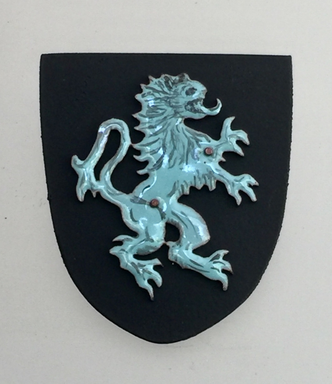 Blue Savage Lion on Black Shield