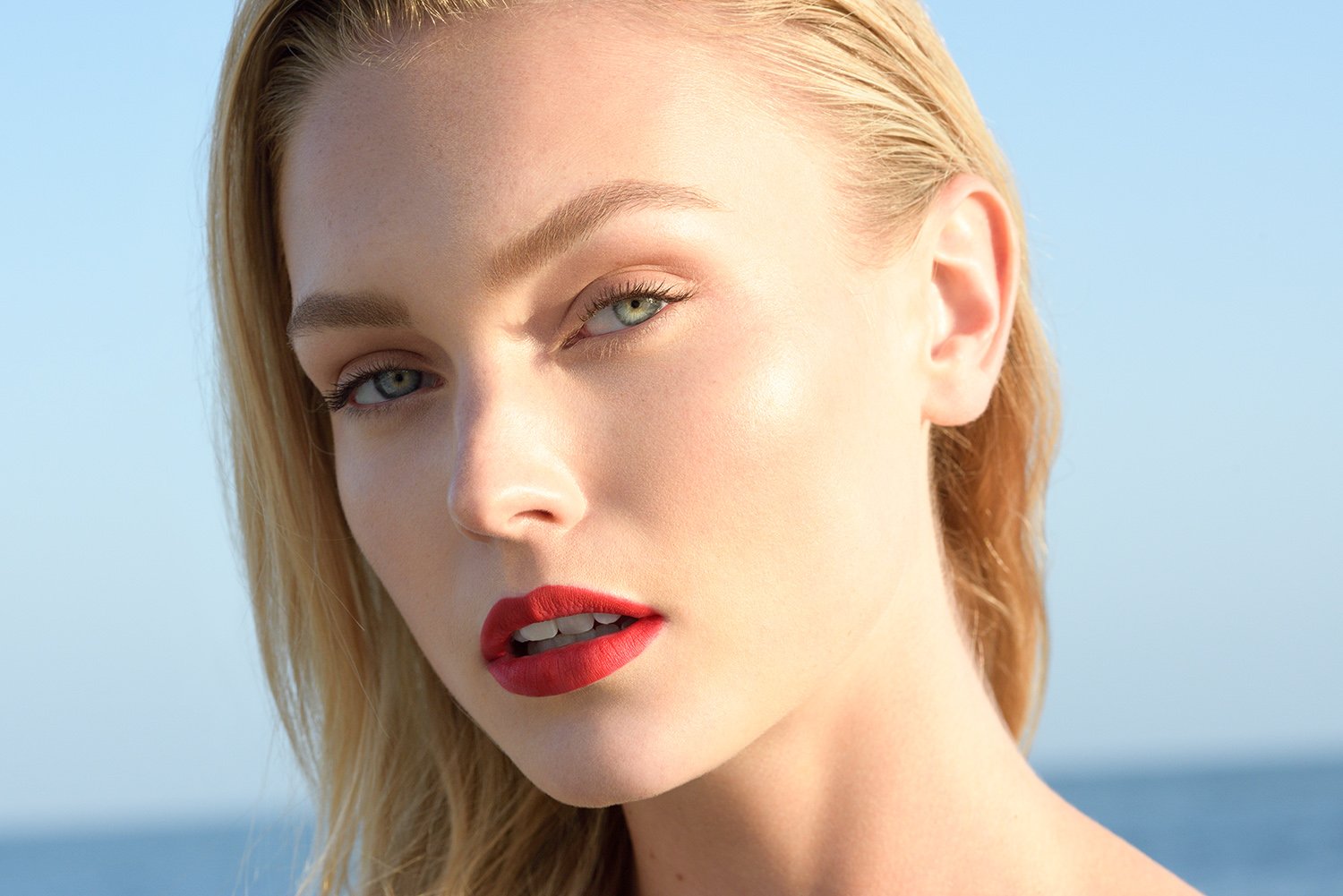Kirra Jones looks stunning in bright red lips for Laugh Kiss Care beauty campaign