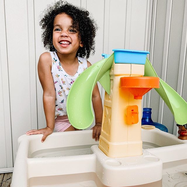 "This is the week! We have officially crossed over into the side of summer where ""everything is boring"" and ""I don't wanna play with my toys"" and ""can we go somewhere"" and ""I'm boooooooored"" 😂 So I bought a cheap water table for outside, had a glass of wine a little too early and you know what? I didn't hear a peep for the rest of the afternoon. Whatever works! 🤷🏾‍♀️🤪 #momlife #momlifeco #toddlers #thisismotherhood #motherhood #newmom #summervibes"