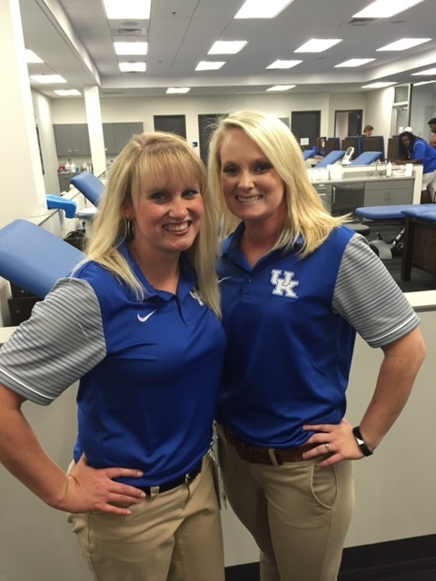 Dr. Kaiser in the athletic training room prior to a UK football game
