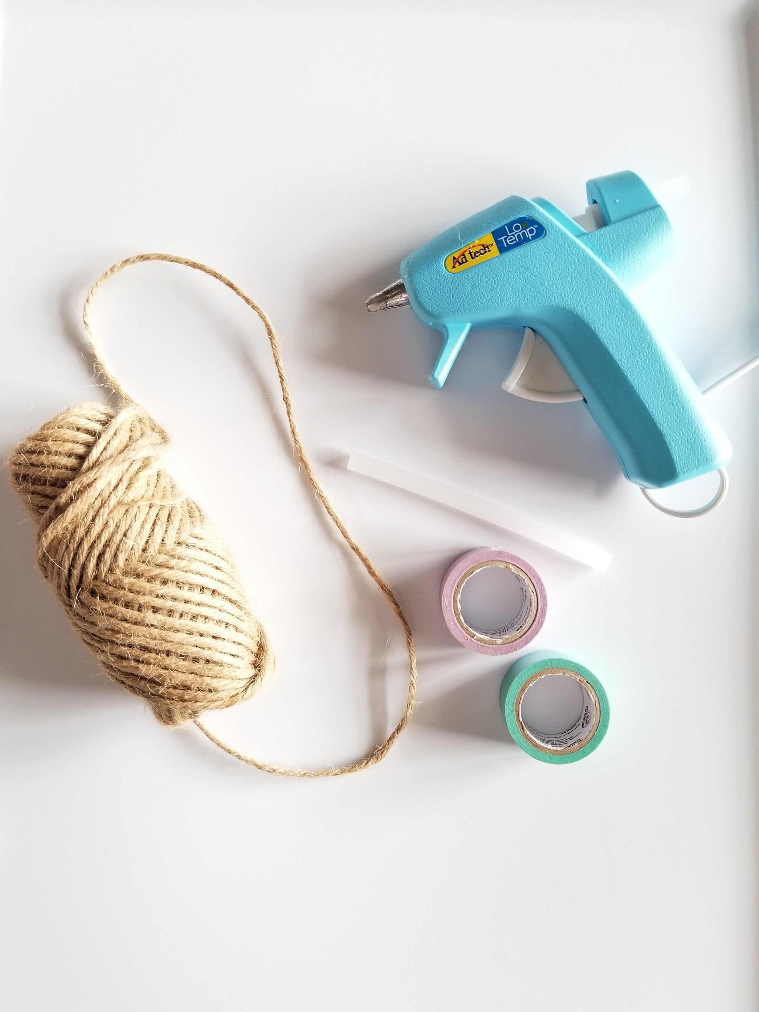 Twine, Duck Washi tape, glue gun and glue sticks.