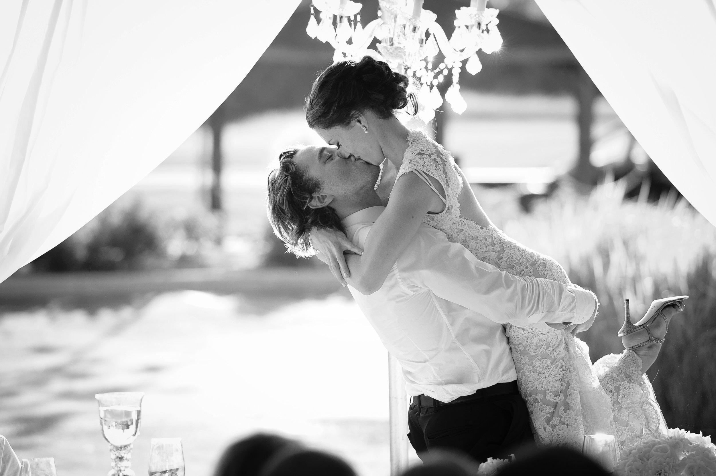 bride-groom-big-kiss-tent.JPG