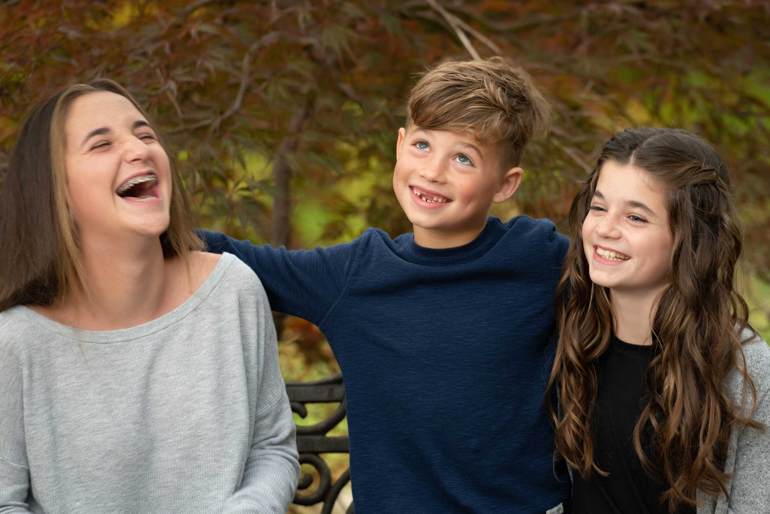 three-siblings-laughing-family-session.jpg