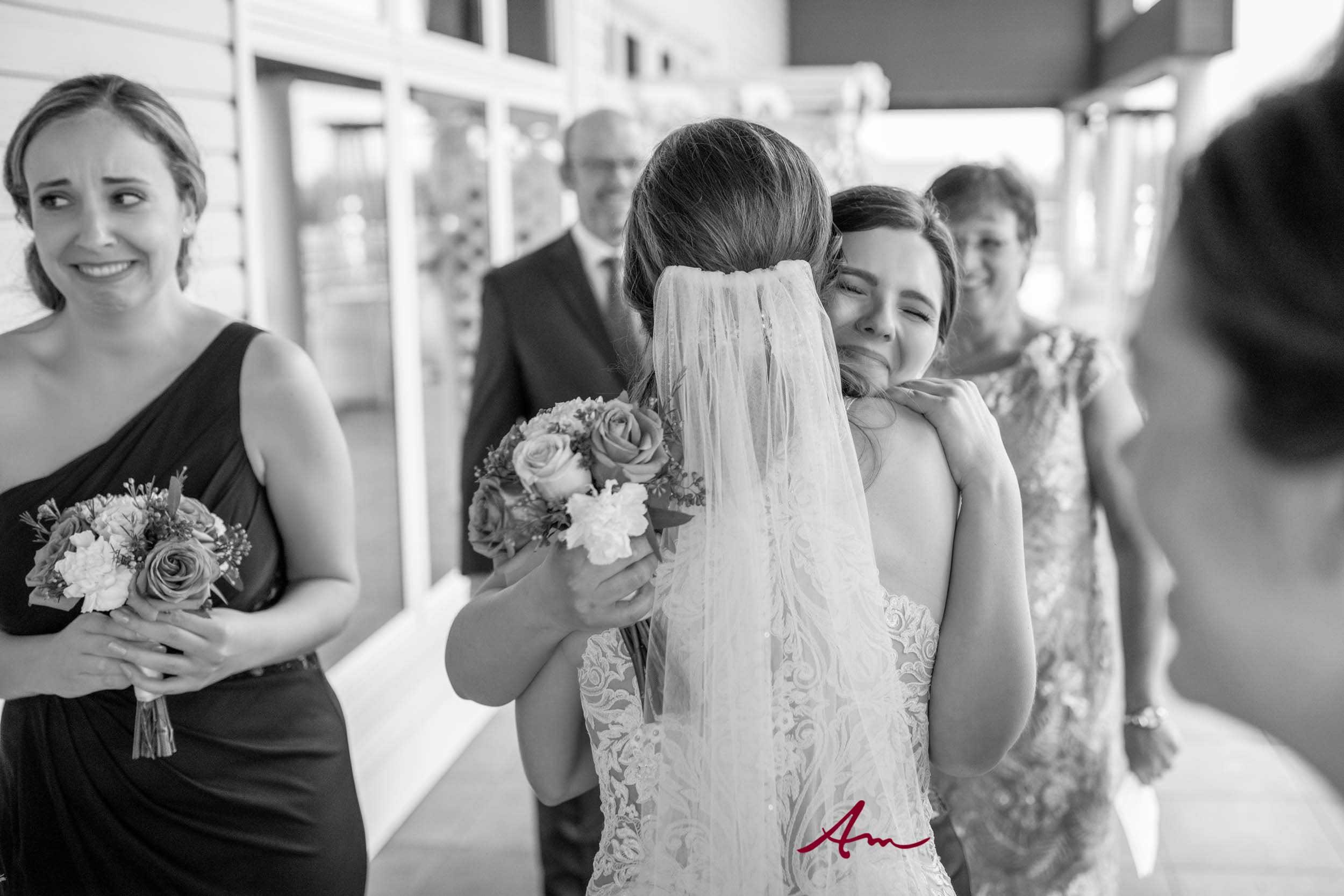 Fox-Harb'r-Wedding-Post-Ceremony-Hugs.jpg