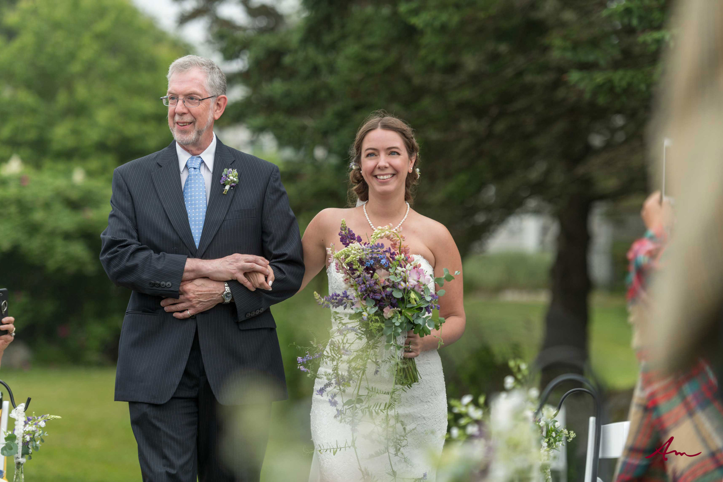 Walking down the aisle with her Dad.