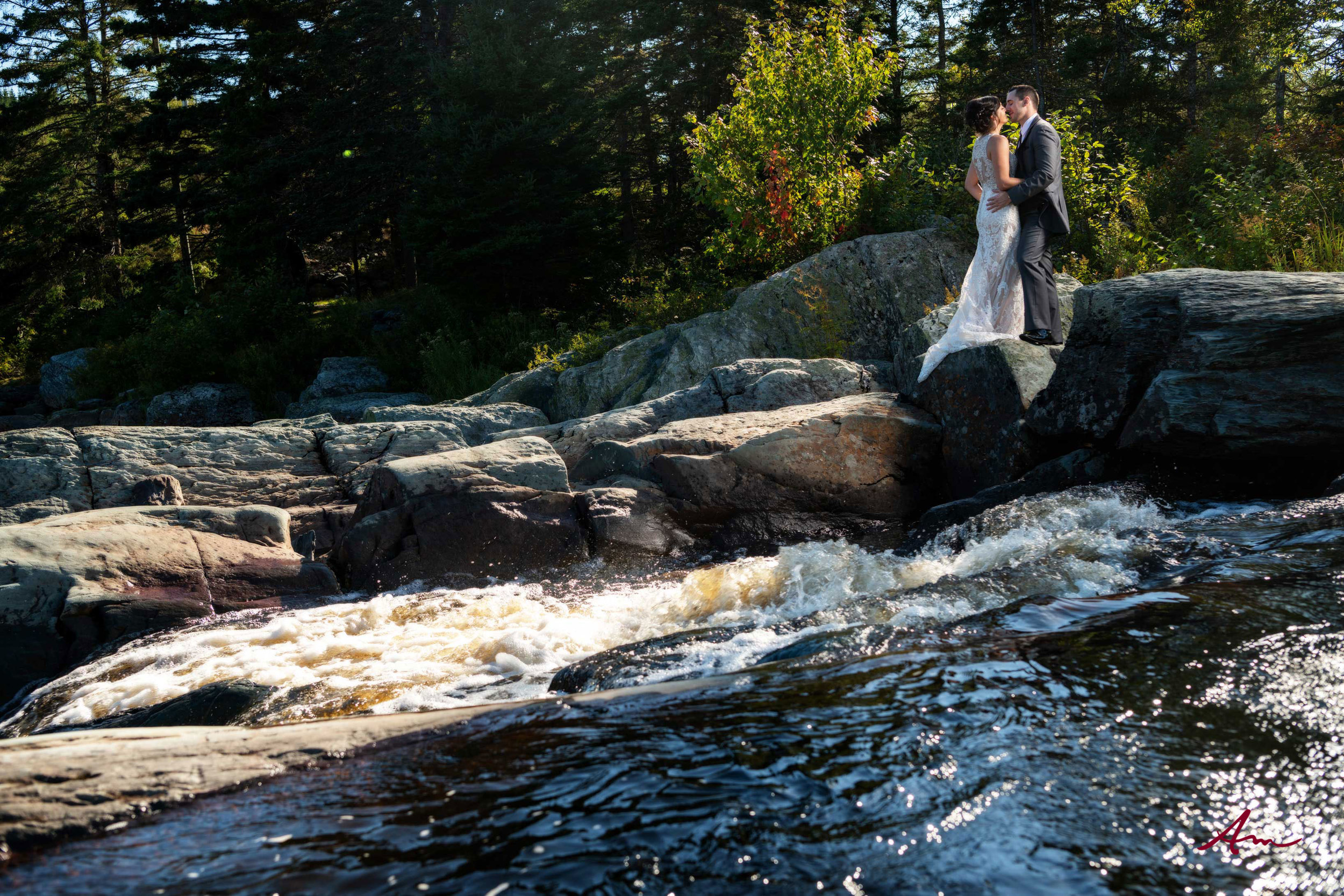 Liscombe-wedding-kissing-by-river.jpg