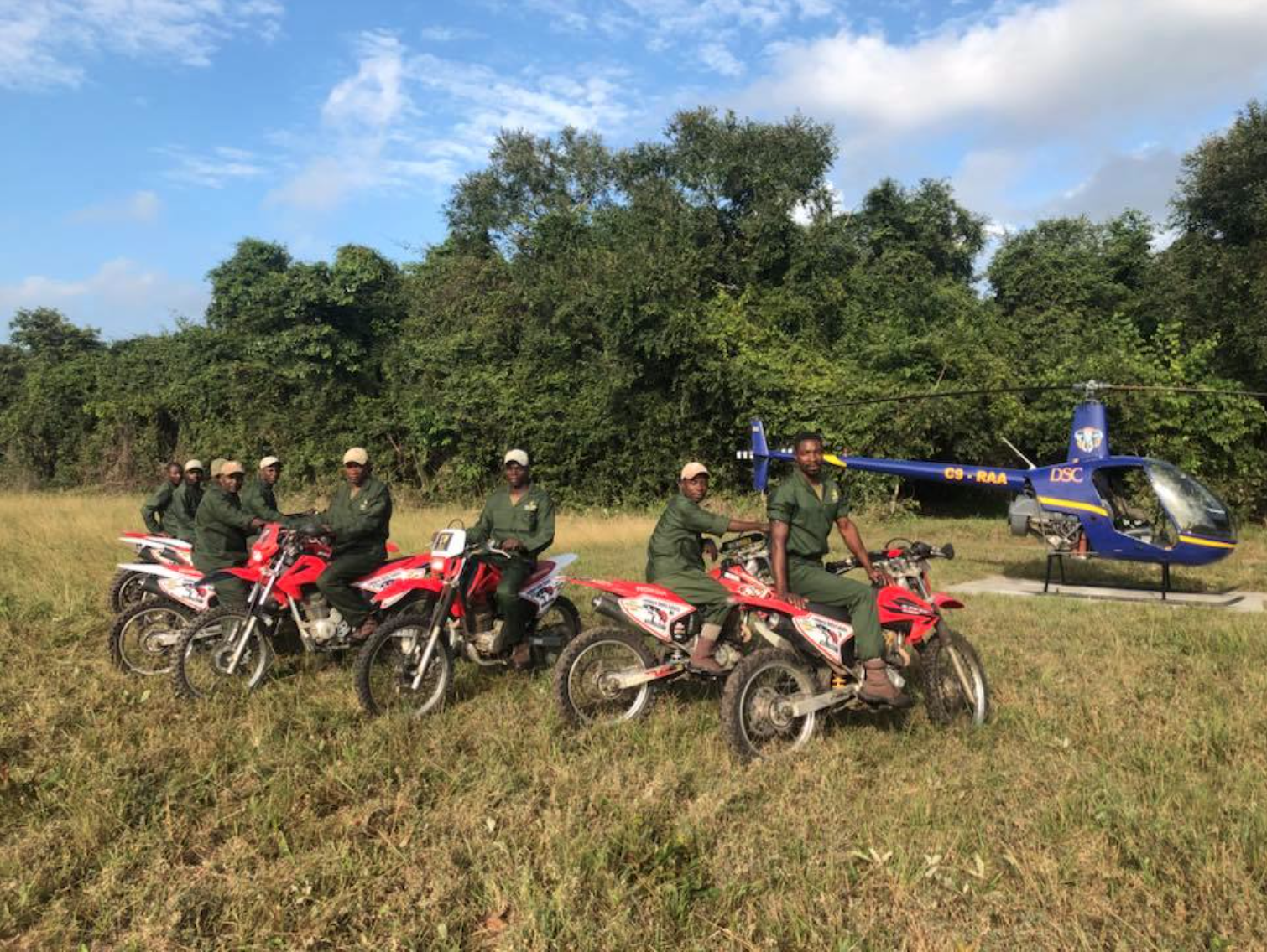 Zambeze Delta Safaris Anti Poaching Team alongside the Dallas Safari Club sponsored Anti Poaching chopper