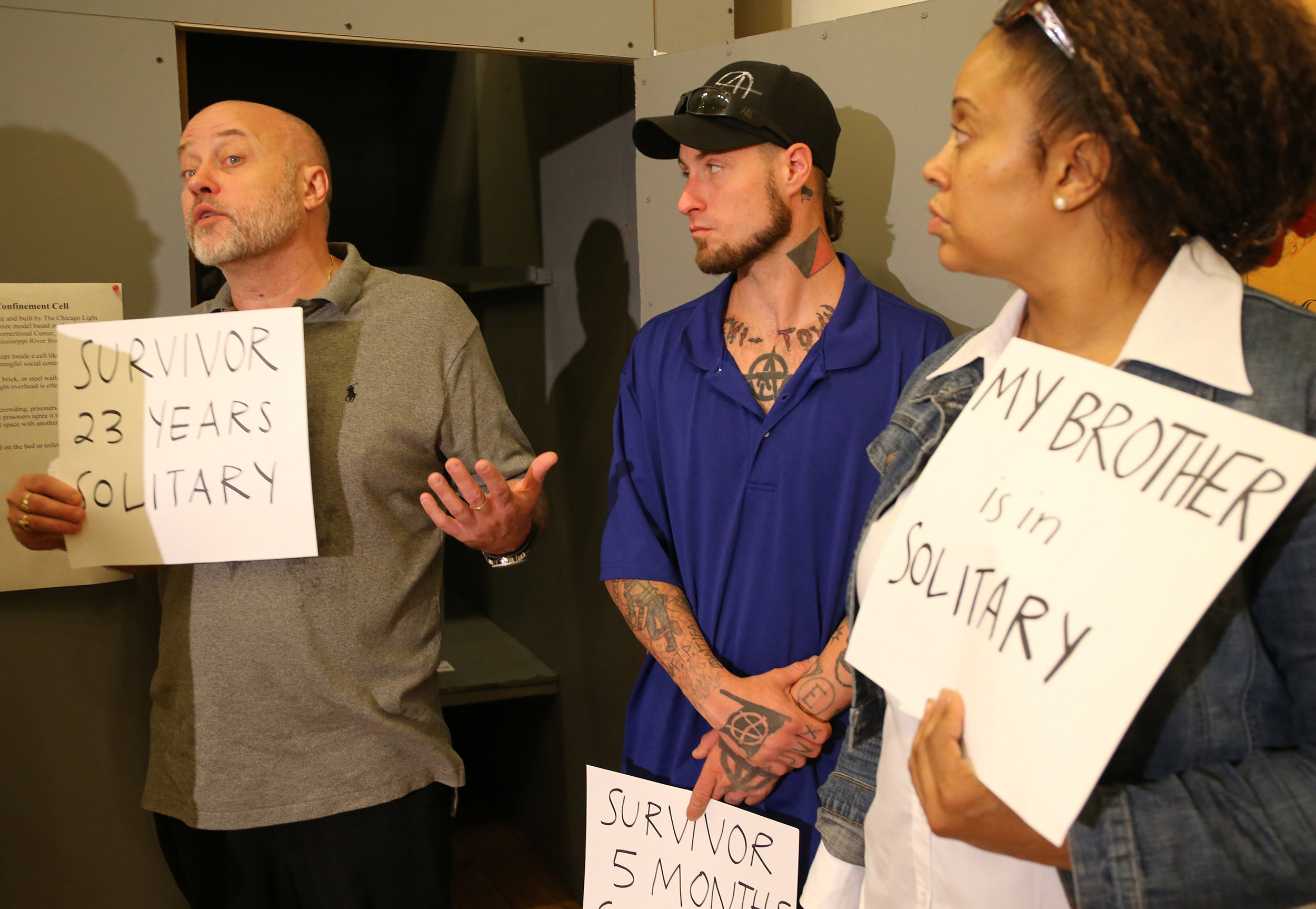 Brian Nelson, left, who spent 23 years in solitary confinement, speaks about his time there on June 24, 2015, during a press conference regarding the class-action lawsuit filed on behalf of prisoners against the Illinois Department of Corrections for its overuse and misuse of solitary confinement in Illinois prisons in Chicago. Antonio Perez/Chicago Tribune/TNS via Getty Images