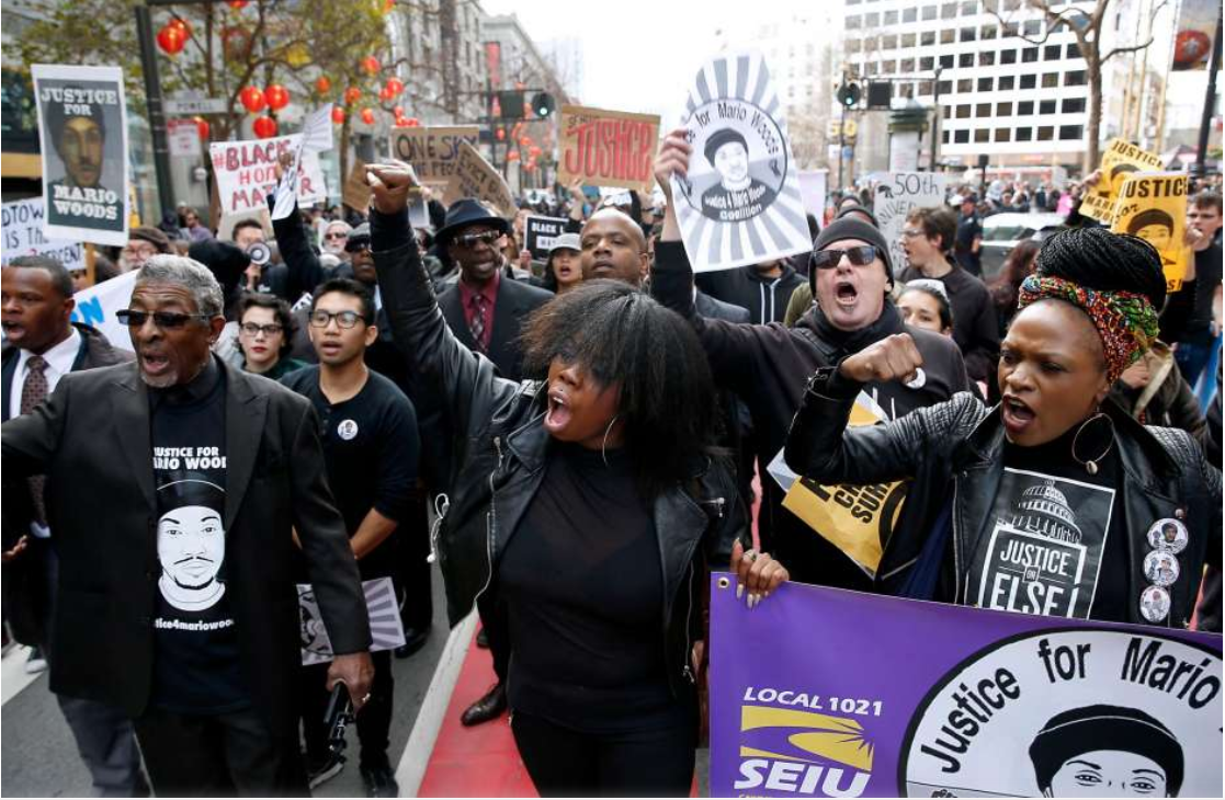 Deja (center) and Cassandra Grant (right) lead protesters demanding justice for Mario Woods, the Bayview man shot and killed by police nearly two months ago, on a march down Market Street to the site of Super Bowl City in San Francisco, Calif. on Saturday, Jan. 30, 2016. Photo: Paul Chinn / The Chronicle