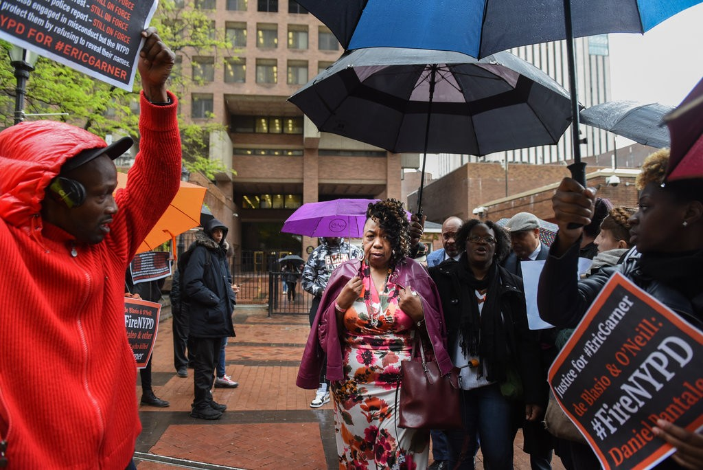 Gwen Carr, the mother of Mr. Garner, outside Police Headquarters on Monday. She left the trial weeping after prosecutors played the video of her son's death. Credit Stephanie Keith for The New York Times