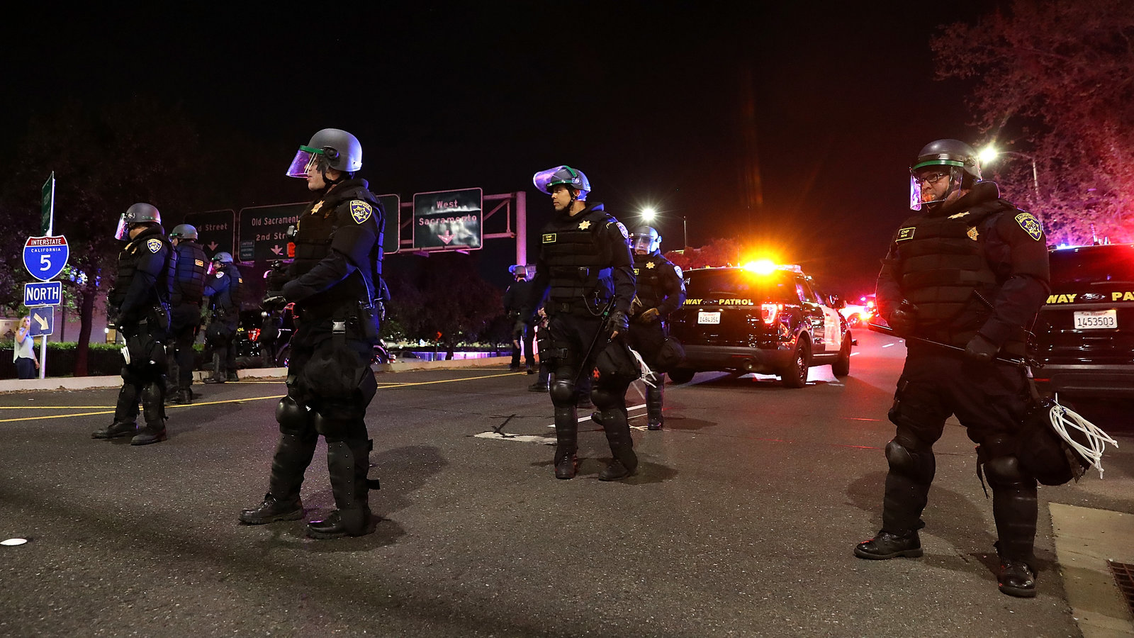 California Highway Patrol officers block an interstate entrance as protesters march. Police use of deadly force became a focus for advocates in California after the district attorney declined to prosecute the officers who fatally shot Stephon Clark, an unarmed black man whose death sparked demonstrations in the state and across the country.  Justin Sullivan/Getty Images