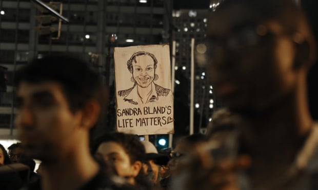 A demonstrator holds a Sandra Bland sign during a vigil in Chicago, Illinois, on 28 July 2015. Photograph: Christian K. Lee/AP