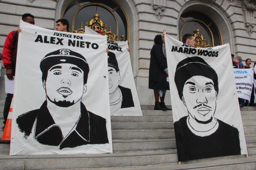City Hall protesters decry the police shootings of Alex Nieto and Mario Woods.