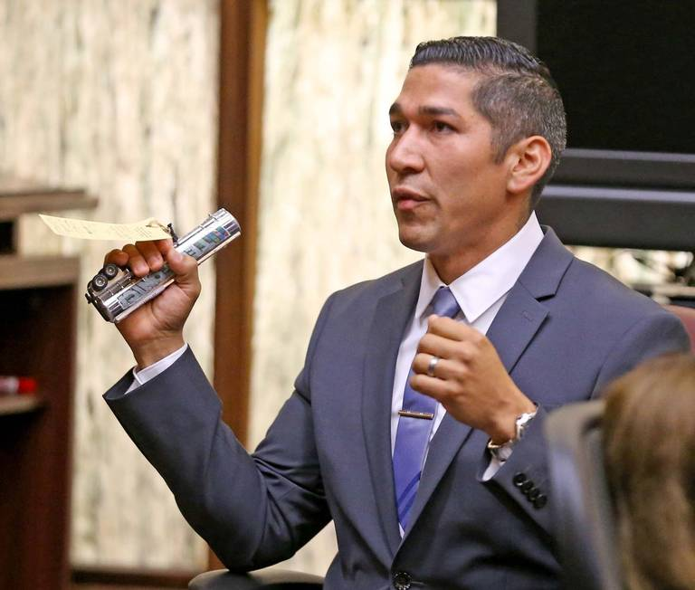 North Miami police officer Jonathon Aledda testifies with the toy mistaken for a gun at his trial over shooting at an autistic man holding the silver toy truck. The jury convicted Aledda of a misdemeanor count of culpable negligence, but acquitted him of two more serious felony counts of attempted manslaughter on Monday night, June 17, 2019. CHARLES TRAINOR JR. CTRAINOR@MIAMIHERALD.COM