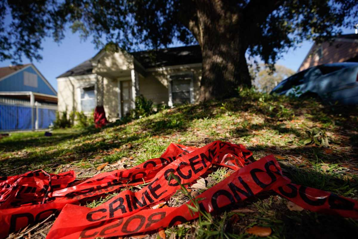 Crime scene tape is shown in the yard of home at 7815 Harding Tuesday, Jan. 29, 2019 where five Houston Police Officers were shot in a gun battle while serving a search warrant on Monday. Police identified the two suspects who died as Rhogena Nicholas, 58, and Dennis Tuttle, 59. Photo: Melissa Phillip, Staff photographer / Houston Chronicle.
