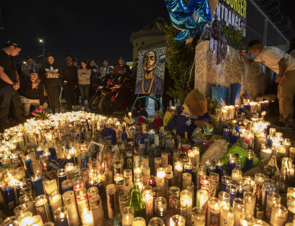 Fans gather at the scene of Nipsey Hussle's shooting in Los Angeles. David McNew/Getty Images