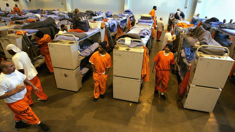 """In a photograph from 2007, inmate beds fill a gymnasium converted into a temporary """"emergency"""" sleeping area at California State Prison, Los Angeles County in Lancaster. This kind of state prison overcrowding is now a thing of the past. (Spencer Weiner / Los Angeles Times)"""