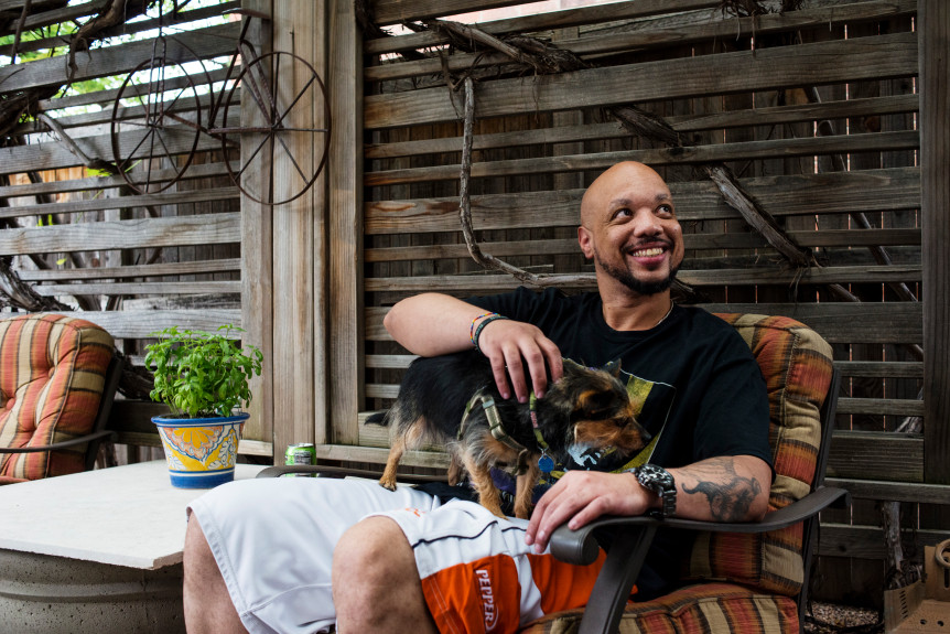 Kelsey Brunner, The Denver Post  Curtis Brooks pets Jack the dog in the yard of Brooks' lawyer Hollynd Hoskins in Denver on Tuesday, July 2, 2019. Brooks was released from Arkansas Valley Correctional Facility yesterday after serving more than two decades in prison. In 1997, Brooks was sentenced to life in prison for his role in a robbery and fatal shooting at the age of 15. In Dec. of 2018, Brooks was granted clemency by then-Gov. John Hickenlooper.