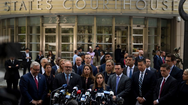 """Joaquin Guzmán, also known as """"El Chapo,"""" was sentenced Wednesday to a life term in prison plus 30 years. After the sentencing in a Brooklyn courthouse, U.S. attorneys and other officials greeted the media, including Ariana Fajardo Orshan, U.S. attorney for the Southern District of Florida.  Johannes Eisele/AFP/Getty Images"""