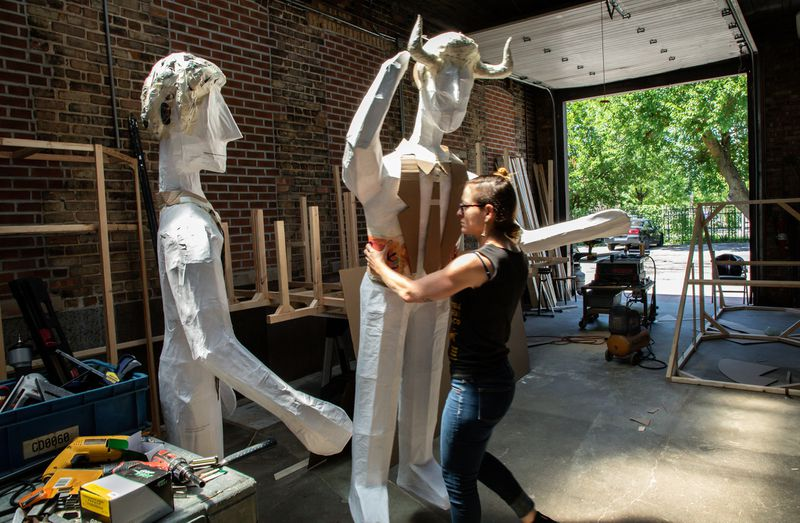 """Mexican artist Adela Goldbard works on her installation titled """"The Last Judgement"""" at a workshop in Little Village in Chicago on July 22, 2019. The large-scale sculpture is commissioned for the Illinois Humanities exhibition called """"Envisioning Justice,"""" which will premiere Aug. 6. (Zbigniew Bzdak / Chicago Tribune)"""