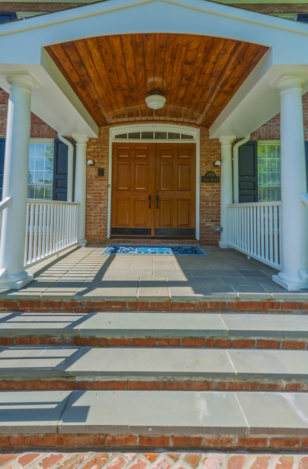 Fine Detail - The crowning glory of this new front porch is the beadboard ceiling, crafted and stained to compliment the existing front door. This fine detail is exquisite, to say the least, adding to the overall polish of the spectacular home.