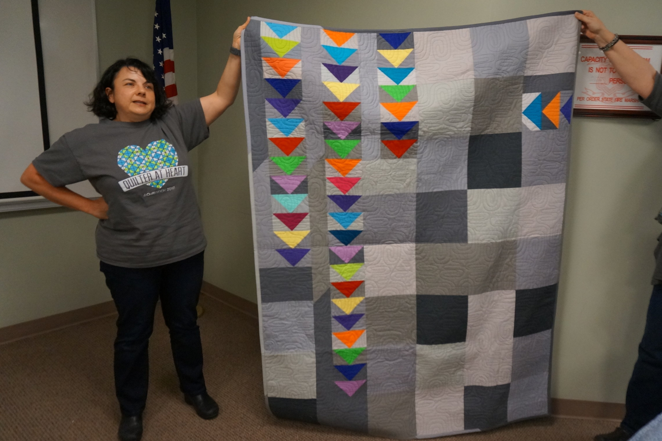 - Chrissy made her recent quilt as part of the guild's flying geese block swap and challenge.