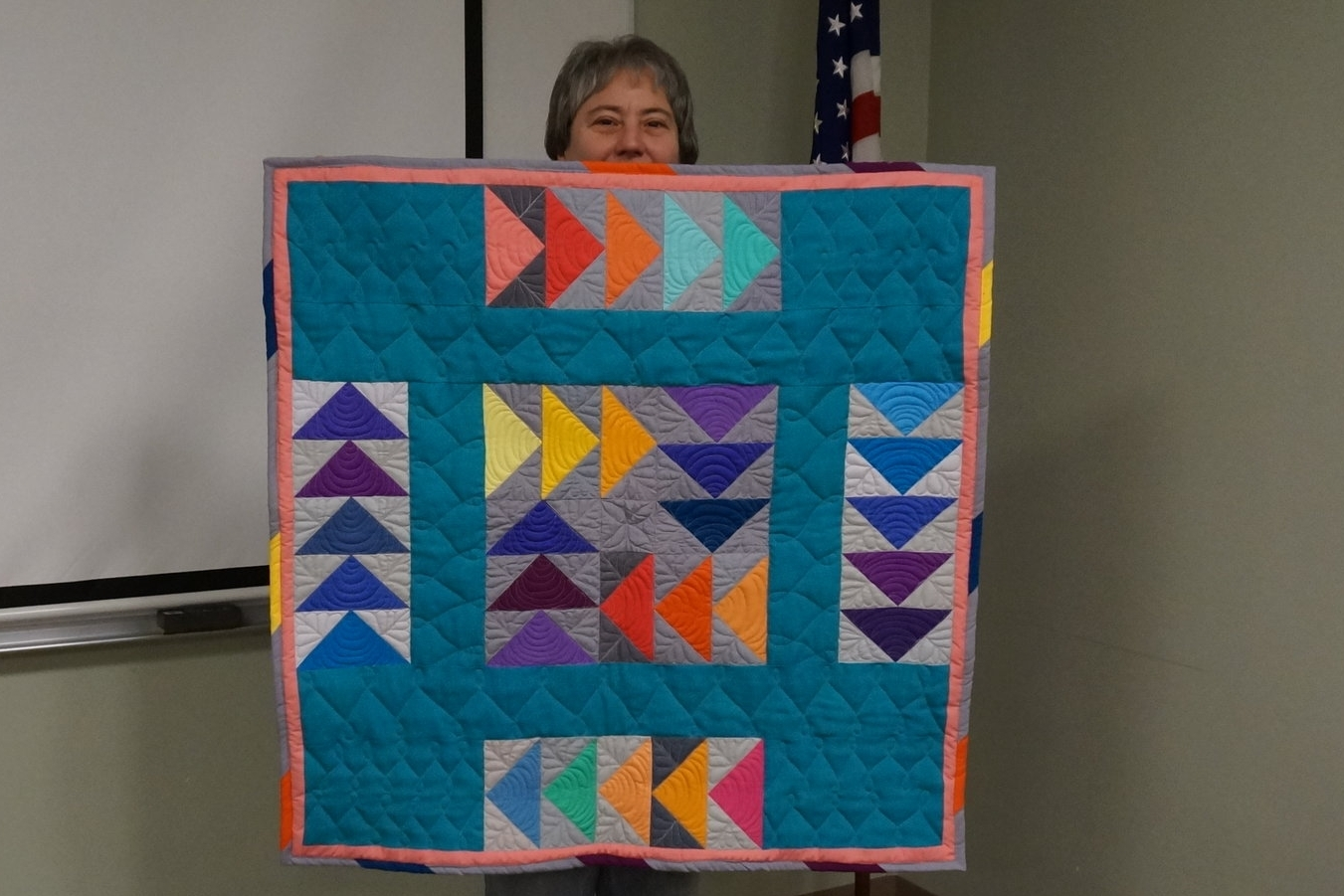 - Lil made her recent wall hanging with flying geese blocks from the guild's block swap.
