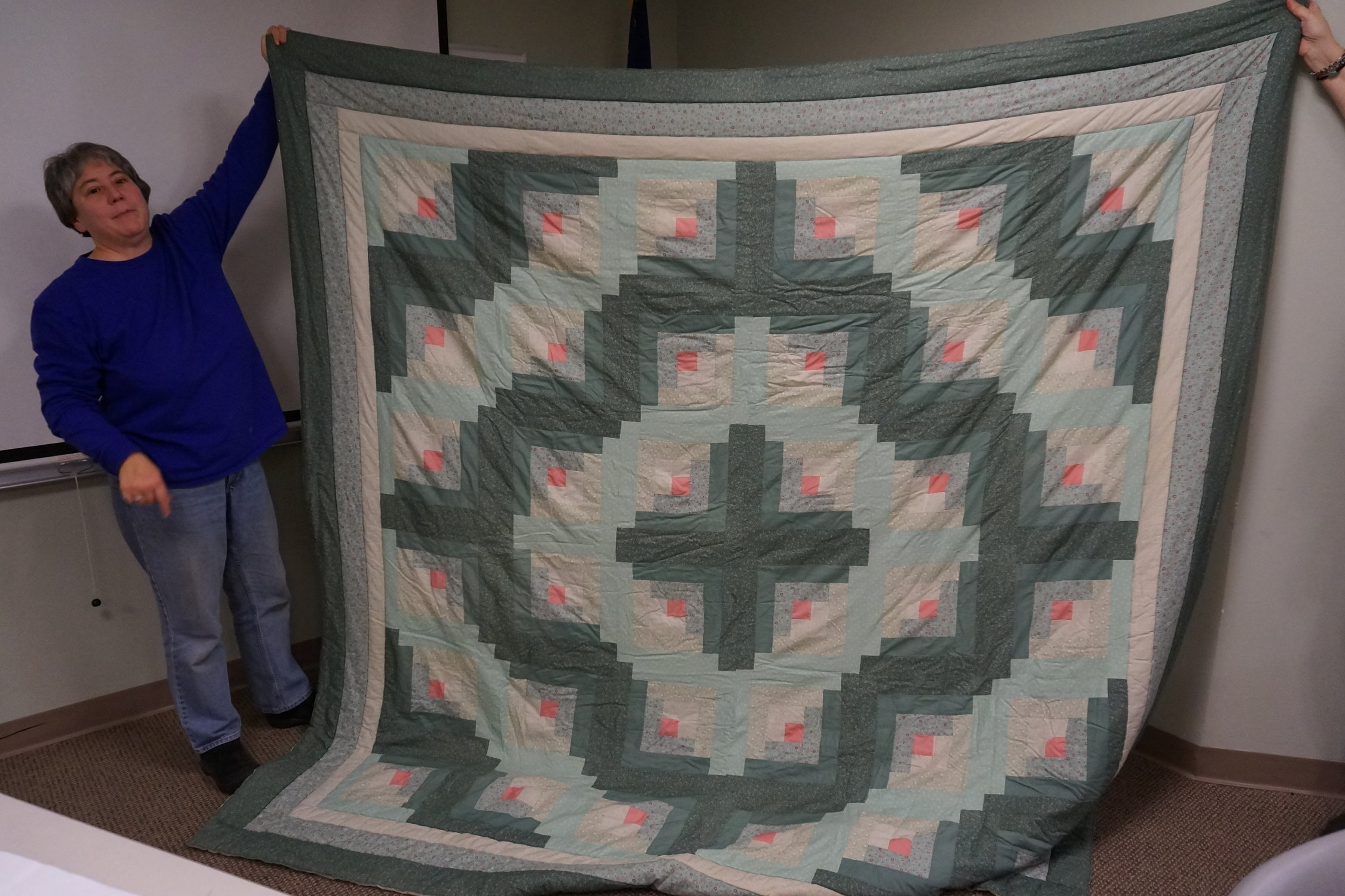 """- Lil's log cabin quilt was from the Eleanor Burns """"Quilt in a Day"""" pattern. She made it for her dad with a double batting and hand-tied it."""