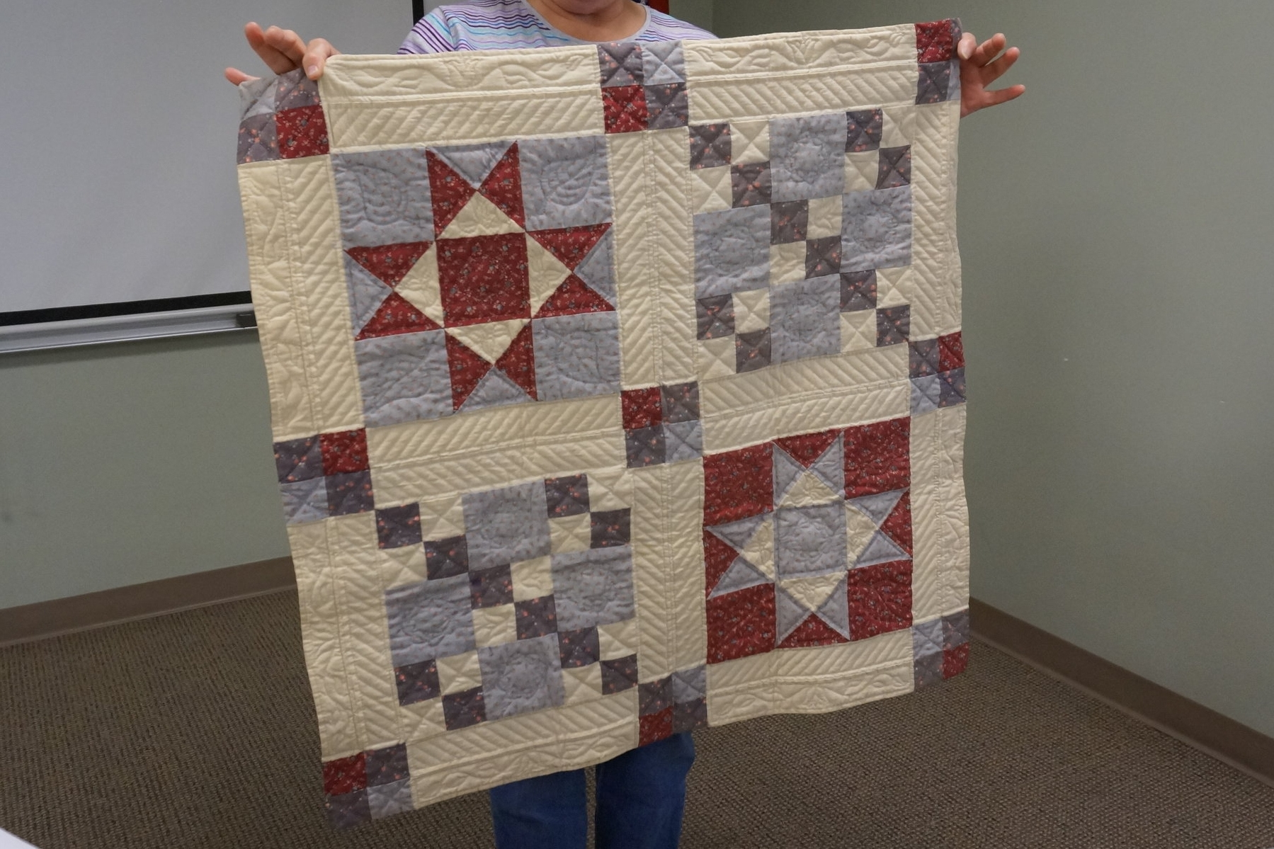 - Sisan made her first quilt in 1988. She hadn't yet learned to make traditional bindings, so she just folded the edges in and stitched them closed.