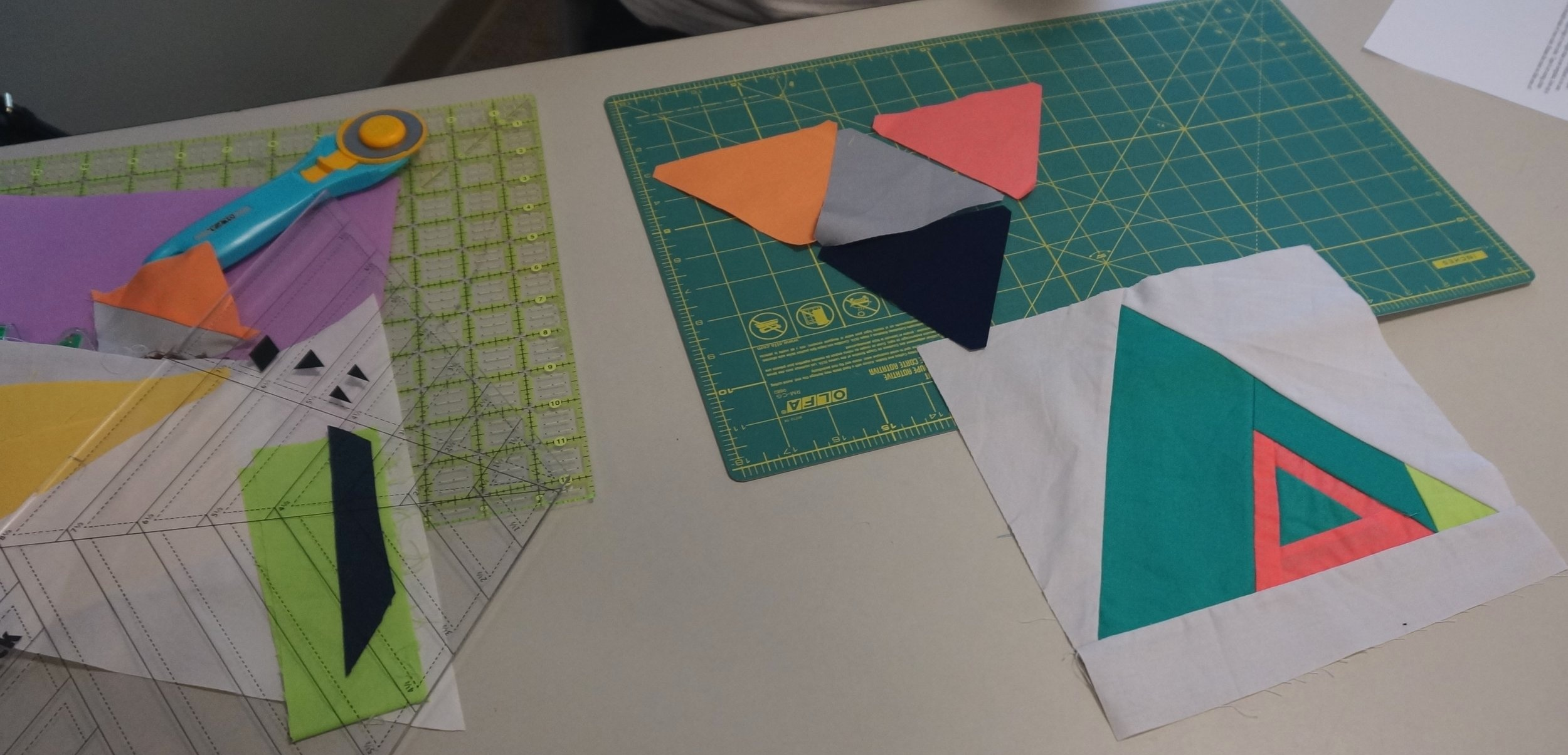Piece together smaller triangles or make a log cabin triangle.