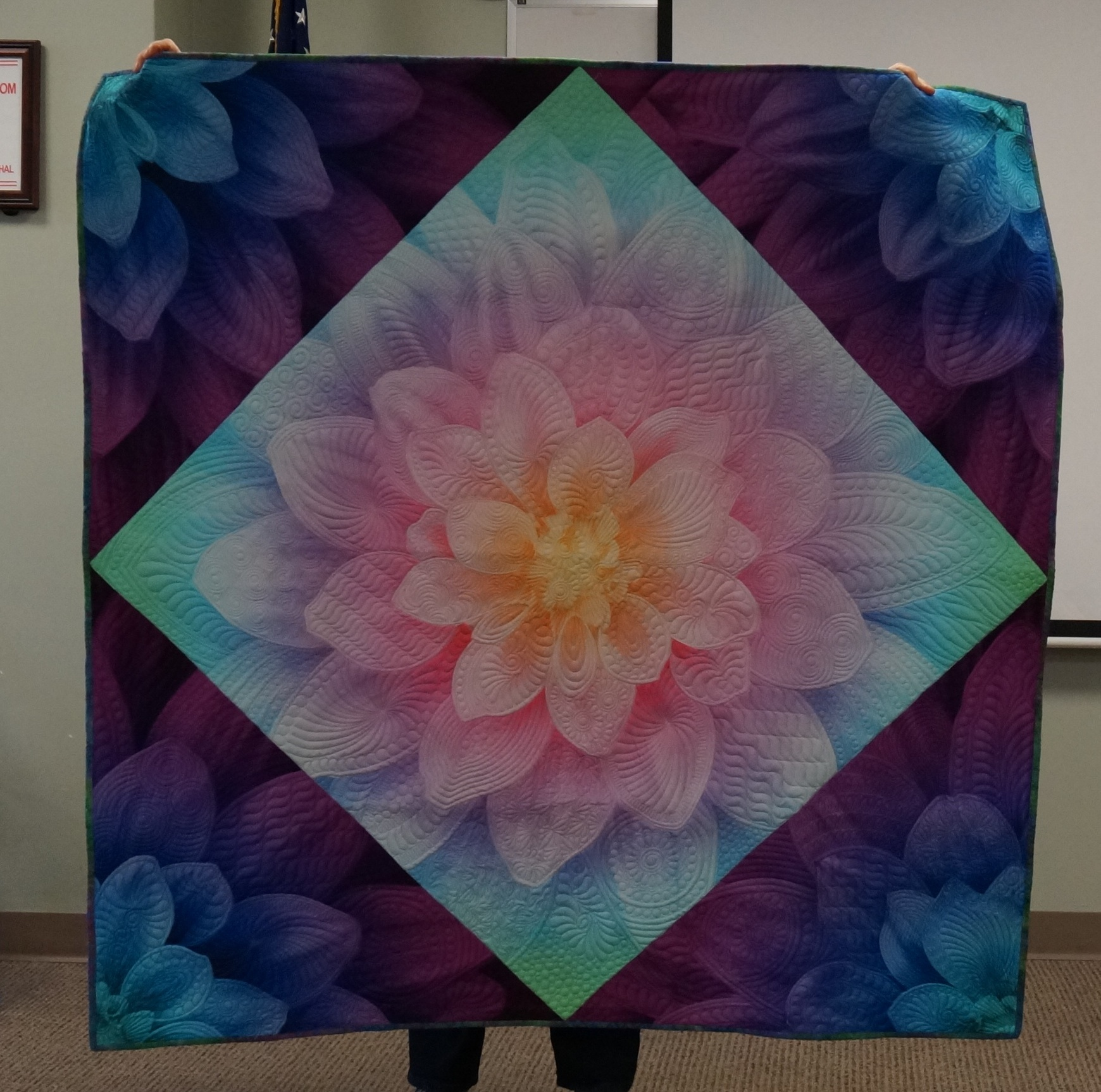 Sue used a panel to show off her stunning quilting.