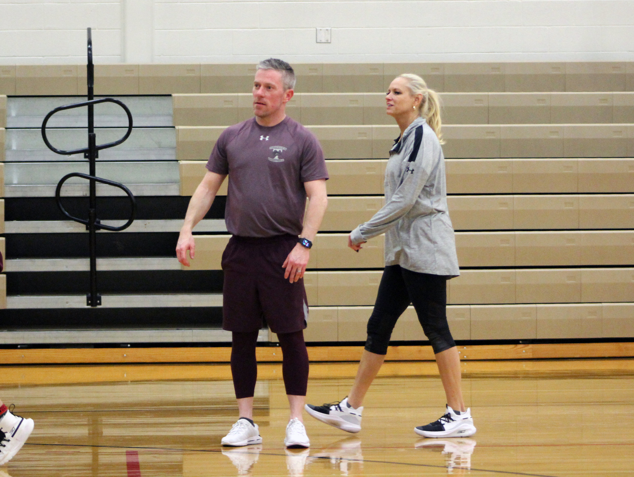 Coach Kit Martin (right) looks on during practice with assistant coach Todd Monsey after playoff win.